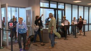 KEYT Reporter Vicky Nguyen greets passengers at airport